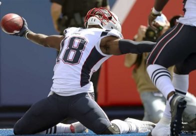 Matthew Slater - Action shot, sliding on both knees with the ball